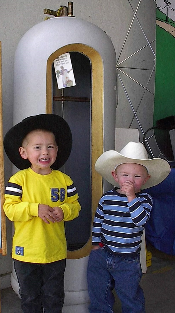 kids at Kremmling, Colo.'s Middle Park Fair & Rodeo pose with electric water heater